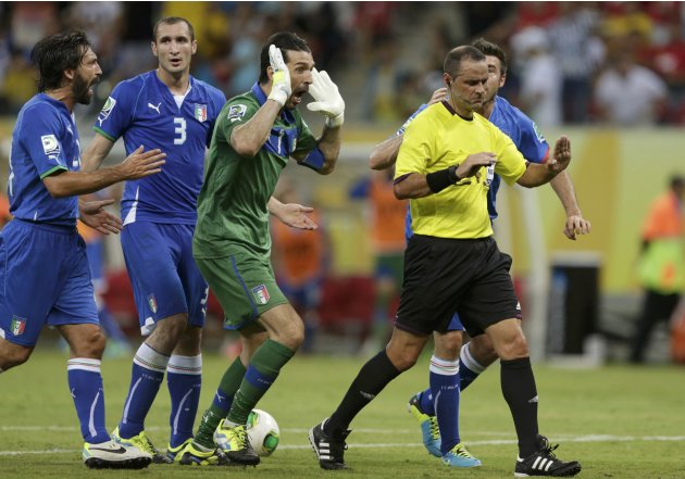 Italy's goalkeeper Buffon reacts after referee Abal awarded a penalty against him during their Confederations Cup Group A soccer match against Japan in Recife