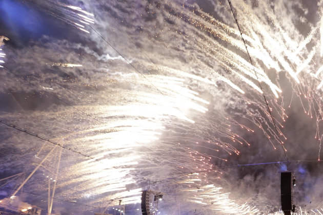 In this Friday, July 27, 2012 photo fireworks explode during the Opening Ceremony at the 2012 Summer Olympics, in London. The International Olympic Committee expects that almost 900 million people watched part of the London Games opening ceremony on television. The IOC&#39;s television and marketing director Timo Lumme says it is the target figure for &quot;global viewership ... that&#39;s all eyeballs across the world.&quot; The final, official rating will be lower than 900 million. It counts in-home viewers watching for longer periods and will be announced within months. Lumme says around 80 of 200 national television markets have audited figures. Others are estimated. (AP Photo/Paul Sancya)