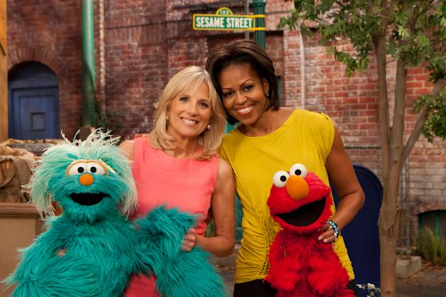 "Michelle Obama and Dr. Jill Biden during a visit ""Sesame Street"" on April 18, 2011"