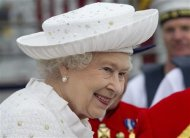 Britain&#39;s Queen Elizabeth embarks from Chelsea Harbour to join the pageant on the River Thames, in London