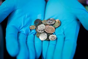 Ancient Coins Found Buried in British Cave