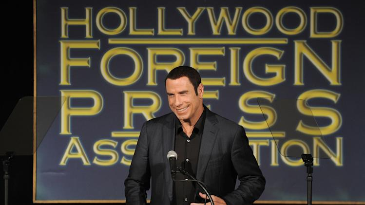 John Travolta speaks at the Hollywood Foreign Press Association luncheon at the Beverly Hills Hotel on Thursday, Aug. 9, 2012, in Beverly Hills, Calif. (Photo by Jordan Strauss/Invision/AP)