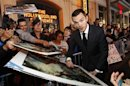 "Cast member Hoult signs autographs at the premiere of ""Jack the Giant Slayer"" in Hollywood, California"