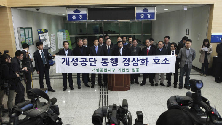 "South Korean small business owners who run factories in the sprawling complex in North Korea's border city of Kaesong, hold a press conference to demand that the North Korea to normalize the border crossings in front of the gateways to North Korea at the customs, immigration and quarantine office in Paju, South Korea, near the border village of Panmunjom, Thursday, April 4, 2013. North Korea on Wednesday barred South Korean workers from entering a jointly run factory park just over the heavily armed border in the North, officials in Seoul said, a day after Pyongyang announced it would restart its long-shuttered plutonium reactor and increase production of nuclear weapons material. The banner reads "" Normalize the border crossings. "" (AP Photo/Ahn Young-joon)"