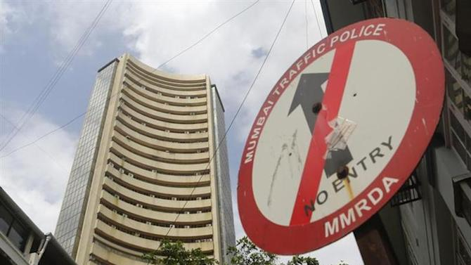 A road sign is seen next to Bombay Stock Exchange (BSE) building in Mumbai August 22, 2013. REUTERS/Danish Siddiqui/Files