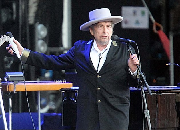 "FILE - This July 22, 2012 file photo shows U.S. singer-songwriter Bob Dylan performing on at ""Les Vieilles Charrues"" Festival in Carhaix, western France.   It's a crowded tour market and everyone is c"
