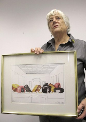 In this Dec. 14, 2012, photo, artist Nancy Peppin poses with her artwork titled &quot;The Last Snack,&quot; modeled after Leonardo da Vinci&#39;s &quot;The Last Supper,&#39;&#39; one of dozens of pieces of art she has created over the years using Twinkies and other Hostess products, in Reno, Nev. A graphic artist by day for slot machine-maker International Game Technology, Peppin doesn&#39;t like to eat Twinkies. She uses them to depict popular culture similar to the work of Andy Warhol. (AP Photo/Scott Sonner)