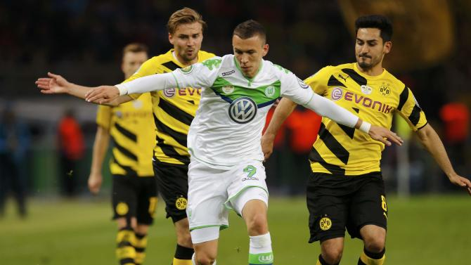 Borussia Dortmund's Schmelzer and Guendogan challenge VfL Wolfsburg's Perisic during their German Cup (DFB Pokal) final soccer match in Berlin