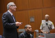 In this pool photo R&B singer Chris Brown, right, appears in court with his attorney Mark Geragos for a probation progress report hearing in Los Angeles Thursday, Nov. 1, 2012. Brown remains on supervised probation for felony assault for an attack on Rihanna in 2009. He is scheduled to return to court Jan. 17, 2013. A California judge says Chris Brown must return to court to update her on the progress of his probation after he completes an overseas tour. (AP Photo/David McNew, Pool)