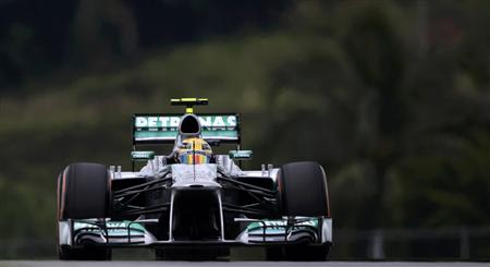 Mercedes Formula One driver Lewis Hamilton of Britain drives during the second practice session of the Malaysian F1 Grand Prix at Sepang International Circuit outside Kuala Lumpur