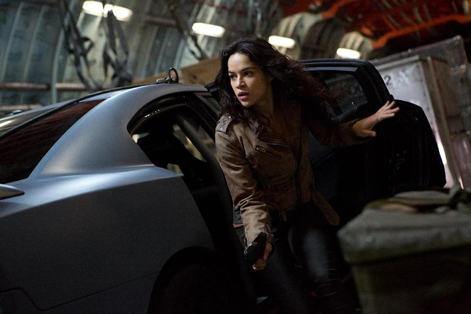 "This film publicity image released by Universal Pictures shows Michelle Rodriguez in a scene from ""Fast & Furious 6."" (AP Photo/Universal Pictures, Giles Keyte)"