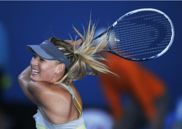 Russia's Maria Sharapova hits a return to Japan's Misaki Doi during their second round match at the Australian Open tennis championship in Melbourne, Australia, Wednesday, Jan. 16, 2013. (AP Photo/Rob