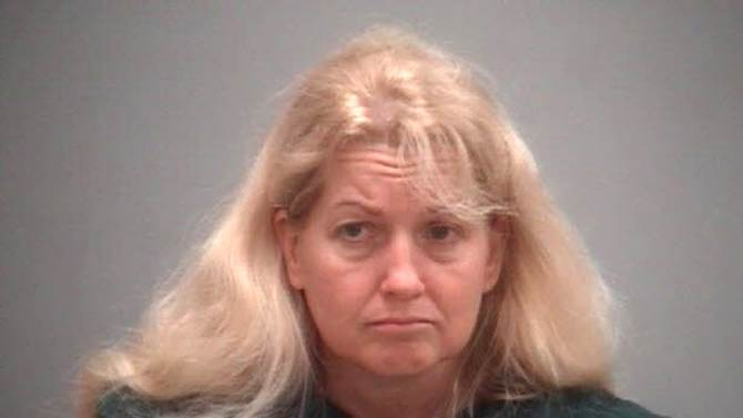 In a photo provided by the Benzie County Sheriff, Kelli Stapleton is shown in a booking photo. The woman accused of trying to kill her autistic daughter in a murder-suicide is locked up without bail in a northern Michigan jail. Stapleton appeared in a Benzie County court Thursday, Sept. 5, 2013 after being released from a hospital. State police say Stapleton and her 14-year-old daughter Isabelle were found unconscious from carbon monoxide poisoning in a van Tuesday. Stapleton has written about Isabelle's severe autism on a blog called The Status Woe. (AP Photo/Benzie County Sheriff, HOPD)