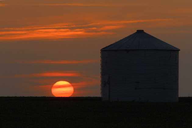 The sun sets in Pleasant Plains, Ill. on Thursday, July 5, 2012. Corn and soybean crops are struggling under dry conditions and a record breaking heat wave that is over most of the country. (AP Photo/Seth Perlman)
