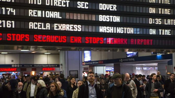 Travelers wait at Pennsylvania Station in New York