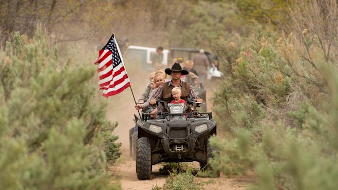 Ryan Bundy, son of the Nevada rancher Cliven Bundy, rides an ATV into Recapture Canyon north of Blanding, Utah on Saturday, May 10, 2014, in a protest against what demonstrators call the federal government's overreaching control of public lands. The area has been closed to motorized use since 2007 when an illegal trail was found that cuts through Ancestral Puebloan ruins. The canyon is open to hikers and horseback riders. (AP Photo/The Salt Lake Tribune, Trent Nelson)