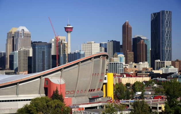 The downtown skyline of Calgary, Alberta with the Saddledome (Scotiabank Saddledome) in the foreground.. The Canadian Press Images/Larry MacDougal