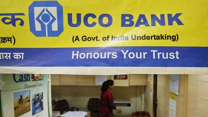 A staff member works inside a commercial branch of the UCO Bank in Mumbai