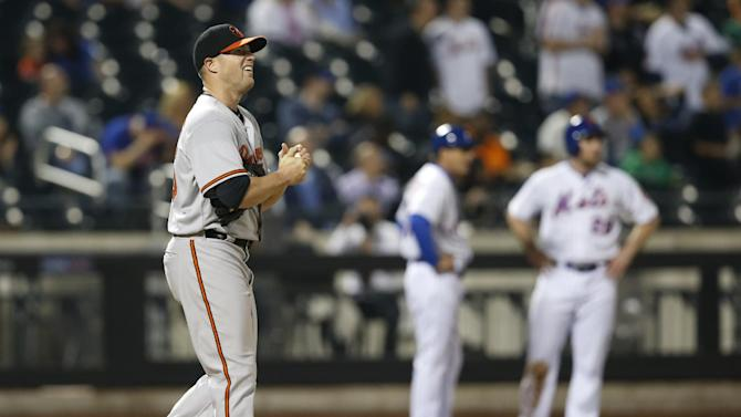 Baltimore Orioles starting pitcher Bud Norris watches a video replay of a Wilmer Flores fourth-inning double in a baseball game against the New York Mets in New York, Tuesday, May 5, 2015. New York Mets Daniel Murphy (28) is at third, far right. (AP Photo/Kathy Willens)