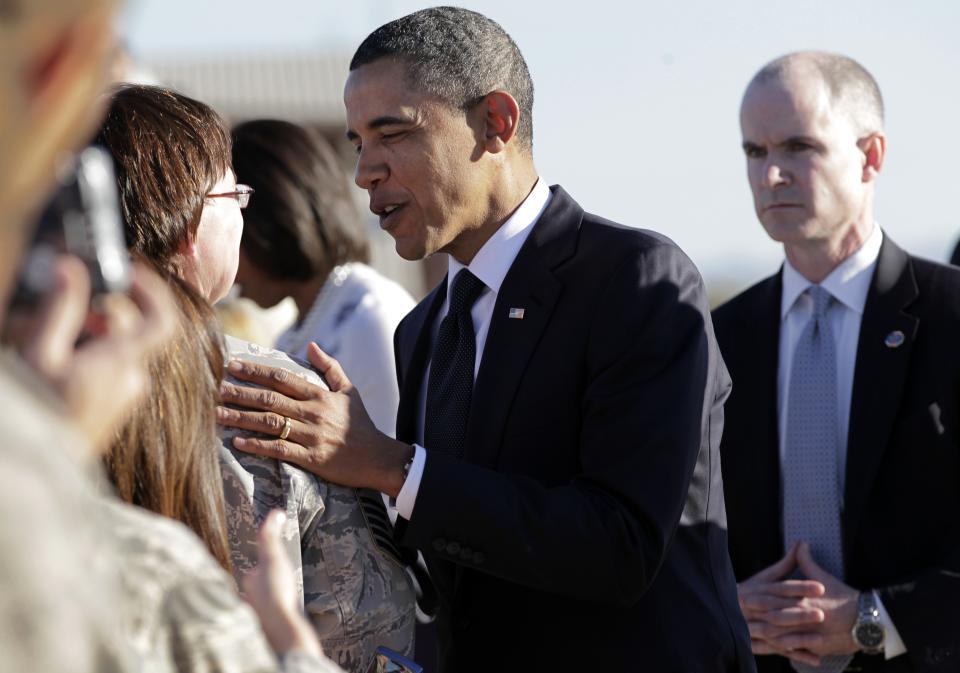 President Barack Obama greet people after arriving in Tucson, Ariz., to attend a memorial service for victims of last Saturday's shooting rampage that killed six people and left 14 injured, including Rep. Gabrielle Giffords, at Davis-Monthan Air Force Base, Wednesday, Jan. 12, 2011.  (AP Photo/J. Scott Applewhite)