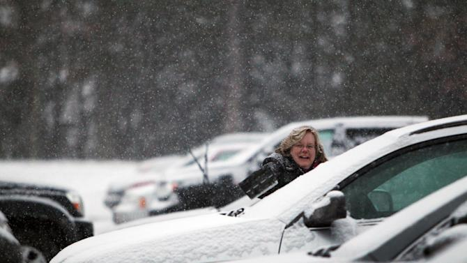 State employees get ready to drive home after another snow storm arrived on Tuesday, Dec. 17, 2013 in Concord, N.H. Up to 6-inches of snow is expected. (AP Photo/Jim Cole)