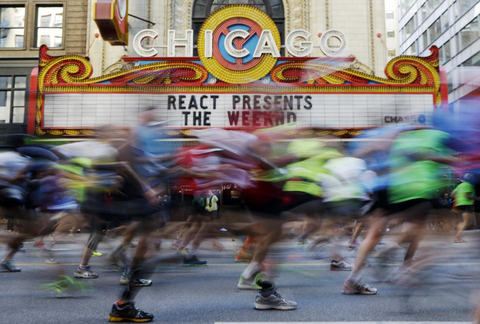 Runners participate in the Chicago Marathon in Chicago, Sunday, Oct. 13, 2013, nearly six months after the Boston Marathon bombings, with more police officers lining race routes and spectator areas. (AP Photo/Nam Y. Huh)