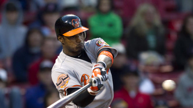 Baltimore Orioles' Adam Jones hits a three-run home run off Boston Red Sox's Darnell McDonald in the 17th inning of a baseball game at Fenway Park, in Boston, Sunday, May 6, 2012. The Orioles defeated the Red Sox 9-6. (AP Photo/Steven Senne)