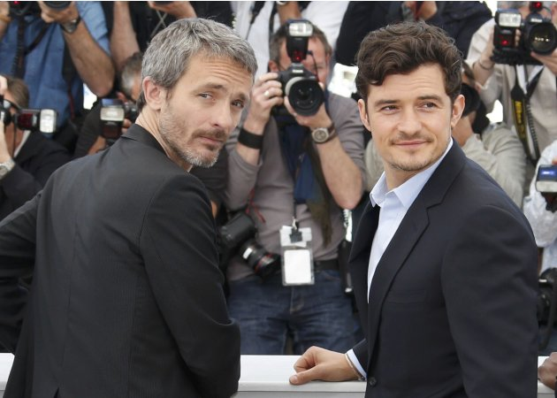 "Director Jerome Salle and cast member Orlando Bloom pose during a photocall for the film ""Zulu"" at the 66th Cannes Film Festival"