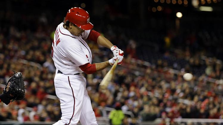 Washington Nationals' Anthony Rendon (6) hits an RBI double during the fourth inning of a baseball game against the St. Louis Cardinals at Nationals Park, Monday, April 22, 2013, in Washington. (AP Photo/Alex Brandon)