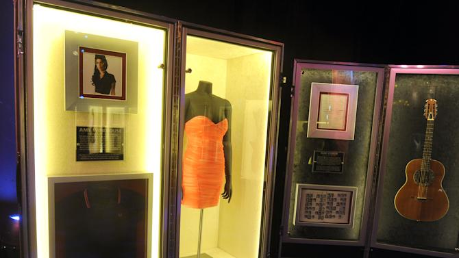 "A pink dress worn on stage by Amy Winehouse in 2008 is on display at Hard Rock International's traveling music memorabilia tour, ""Gone Too Soon, "" Wednesday, Feb. 13, 2013, at Hard Rock Cafe New York.  ""Gone Too Soon"" pays tribute to music icons whose lives and career where tragically cut short and will be on tour at Hard Rock locations in the U.S. throughout 2013. (Photo by Diane Bondareff/Invision for Hard Rock International/AP Images)"