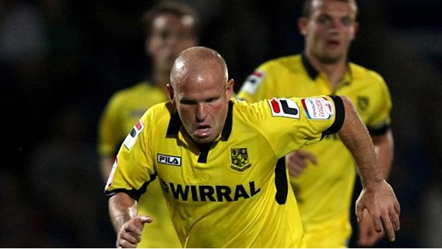 League One - Robinson stays with Tranmere Rovers