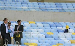 FIFA Secretary General Valcke, former Brazilian striker Ronaldo and Luis Fernandes, executive secretary of the Ministry of Sports, look on during a visit to the Maracana Stadium in Rio de Janeiro