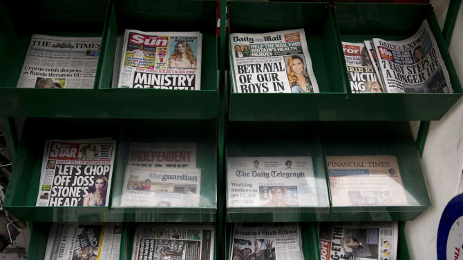 A selection of mostly British newspapers are displayed on sale outside a newsagents in London, Tuesday, March 19, 2013.  Britain's politicians have finally struck a deal to regulate their country's press. Whether the media will allow itself to be regulated is another question.  Across Britain, newspaper front pages voiced disquiet at the establishment of an independent watchdog which would have the power to order prominent apologies and take complaints into arbitration.  (AP Photo/Matt Dunham)