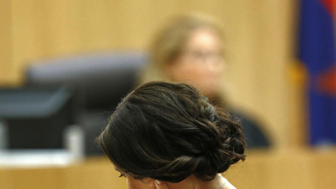 "Samantha Alexander, sister of murder victim Travis Alexander, makes her ""victim impact statement"" to the jury on Thursday, May 16, 2013, during the penalty phase of the Jodi Arias trial at Maricopa County Superior Court in Phoenix.  Jodi Arias was convicted of first-degree murder in the stabbing and shooting to death of Travis Alexander, 30, in his suburban Phoenix home in June 2008. (AP Photo/The Arizona Republic, Rob Schumacher, Pool)"