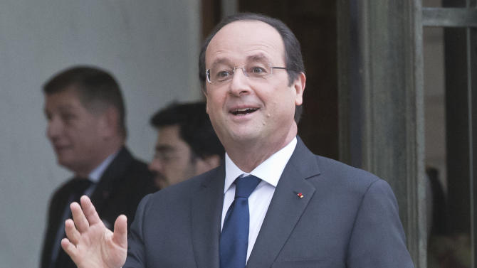 French President Francois Hollande, makes a joke towards the media after a lunch with Belgian King Philippe and Queen Mathilde at the Elysee Palace in Paris, Thursday, Feb. 6, 2014. (AP Photo/Michel Euler)