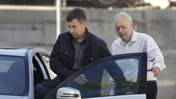 Ruslan Tsarni, left, uncle of killed Boston Marathon bombing suspect Tamerlan Tsarnaev, departs the Graham, Putnam, and Mahoney Funeral Parlors, in Worcester, Mass., as funeral director and owner Peter Stefan, right, walks him to his car, Sunday, May 5, 2013. Stefan has pleaded for government officials to use their influence to convince a cemetery to bury Tsarnaev, but so far no state or federal authorities have stepped forward. (AP Photo/Steven Senne)