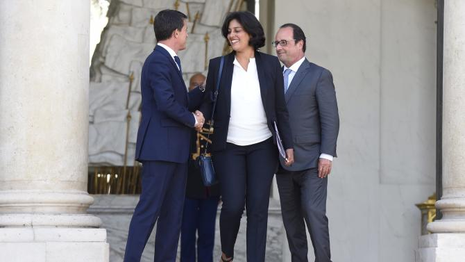 French Prime Minister Manuel Valls shakes hands with newly-named Labour Minister Myriam El Khomri as French President Francois Hollande looks on at the Elysee Palace in Paris