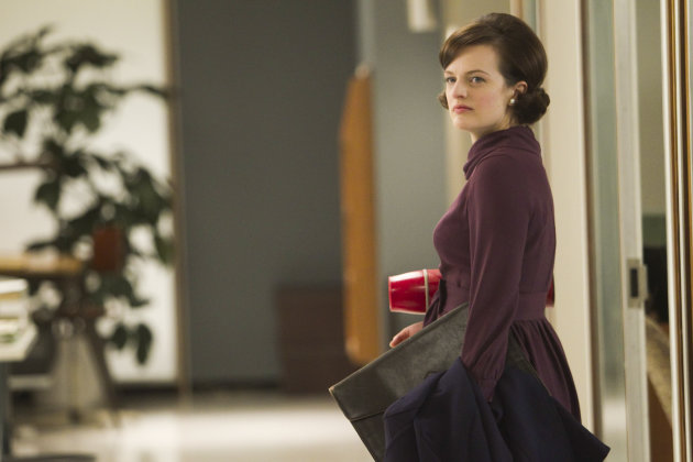 In this publicity photo released by AMC, Elisabeth Moss as Peggy Olson is shown in Episode 11, Season 5, of &quot;Mad Men.&quot; Moss was nominated for an Emmy award on Thursday, July 19, 2012 for outstanding actress in a drama series for her role as Peggy Olson. The 64th annual Primetime Emmy Awards will be presented Sept. 23 at the Nokia Theatre in Los Angeles, hosted by Jimmy Kimmel and airing live on ABC. (AP Photo/AMC, Jordin Althaus)