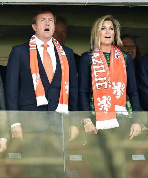 FILE - In this June 18, 2014 file photo, Dutch King Willem-Alexander and his wife, Argentine-born Maxima, sing the national anthem before the start of the World Cup soccer match between Australia and the Netherlands at the Estadio Beira-Rio in Porto Alegre, Brazil. The World Cup semifinal between the Netherlands and Argentina on Wednesday, July 9, 2014 could produce some split loyalties in the House of Orange. (AP Photo/Martin Meissner, File)