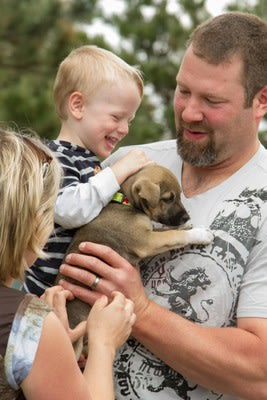 Joyful family adopts their fur-ever friend!