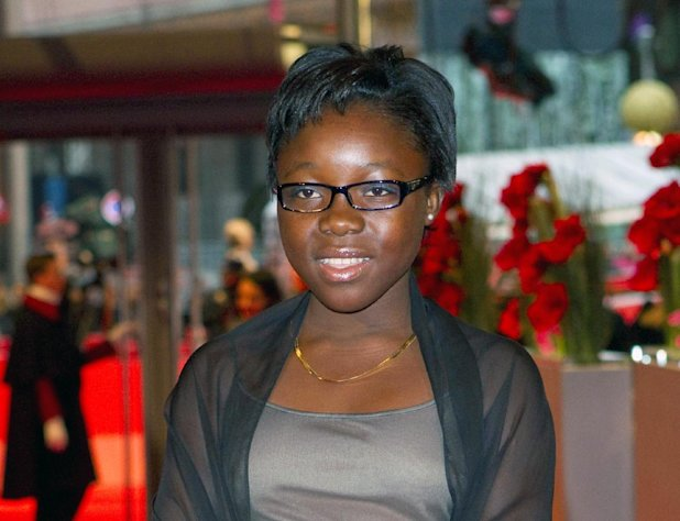 "FILE - This Feb. 17, 2012 file photo shows actress Rachel Mwanza arrives for the screening of the film ""War Witch"" (Rebelle) at the 62 edition of International Film Festival Berlinale, in Berlin. Mwanza has been granted a visa to travel from the Congo for the Academy Awards. The film was nominated for an Academy Award for best foreign picture on Jan. 10, 2013. The 85th Academy Awards will air live on Sunday, Feb. 24. (AP Photo/Gero Breloer, file)"