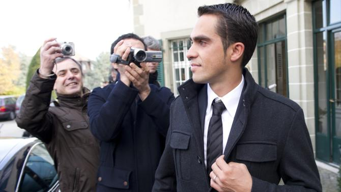 File - In this November 24, 2011 file photo cyclist Alberto Contador, of Spain leaves after the last day of a hearing at the Court of Arbitration for Sport (CAS) in Lausanne, Switzerland. Sport's highest court on Monday Feb. 6, 2012 has banned Contador for two years after finding the Spanish cyclist guilty of doping, a decision that will strip the 2010 Tour de France champion of his title.The Court of Arbitration for Sport has suspended Contador after rejecting his claim that his positive test for clenbuterol was caused by eating contaminated meat.Contador has continued racing since giving a positive control on a 2010 Tour rest day, and is expected to be stripped of all of his results over the past 17 months including winning the Giro d'Italia last season.(AP Photo/keystone/Jean-Christophe Bott, File)