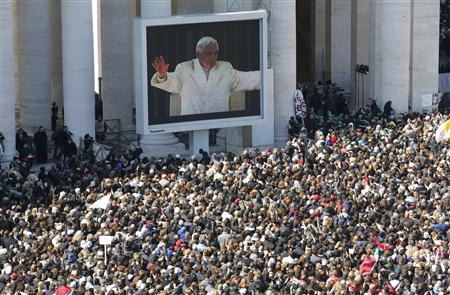 Pope Benedict XVI appears on a giant screen in a packed Saint Peter's Square at the Vatican during his last general audience, February 27, 2013. REUTERS/Stefano Rellandini