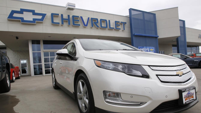In this Sunday, Feb. 19, 2012 photo, a 2012 Volt priced at more than $45,000 is displayed for sale outside at a Chevrolet dealership in the south Denver suburb of Englewood, Colo. General Motors is suspending production of its Chevrolet Volt electric car for five weeks in hopes of reducing inventory to meet lower-than-expected demand. A GM spokesman said Friday, March 2, 2012 that the company will shut down production of the Volt from March 19 until April 23. (AP Photo/David Zalubowski)