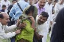 In this photo taken on Saturday, Sept. 8, 2012, A Pakistani police official and a Christian volunteer escort a young Christian girl accused of blasphemy, towards a helicopter following her release from central prison on the outskirts of Rawalpindi, Pakistan. The apparent collapse of a case against a Christian girl accused of burning pages of a Quran has given a dim ray of hope to critics of Pakistan?s blasphemy laws, some of the harshest in the Muslim world. (AP Photo/Anjum Naveed,file)