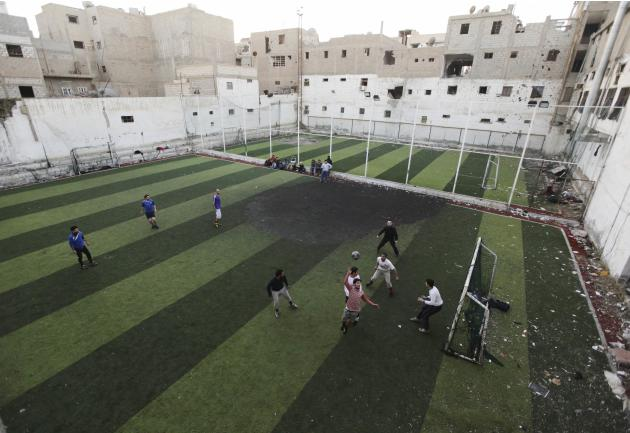 Free Syrian Army fighters play soccer in Deir al-Zor