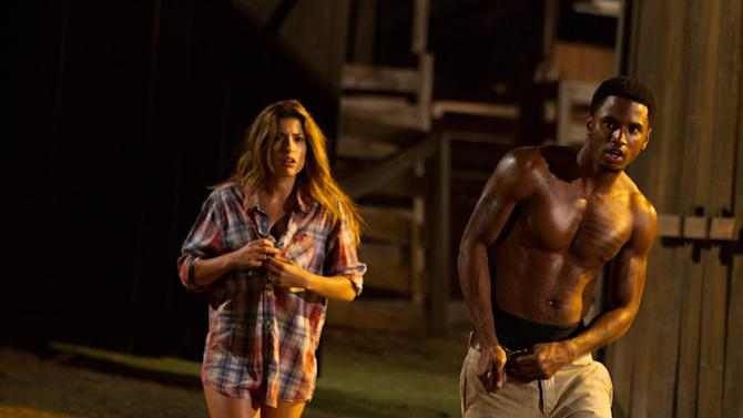 """This undated publicity film image from Lionsgate shows Tania Raymondei, left, as Nikki, and Tremaine """"Trey Songz"""" Neverson, as Ryan, in a scene from """"Texas Chainsaw 3-D,"""" releasing in theaters on Friday, January 4, 2013.  (AP Photo/Lionsgate, Justin Lubin)"""