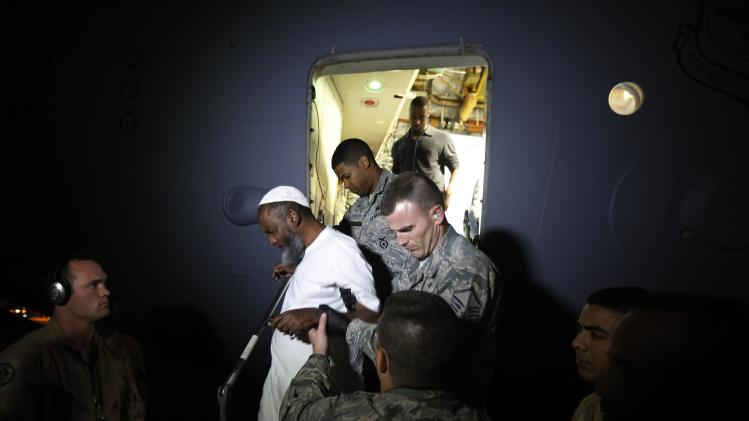U.S. marines assist Sudanese Mohammed Noor, one of two Sudanese detainees released from the Guantanomo facility in Cuba, as he disembarks from an U.S. Air Force plane in Khartoum Airport