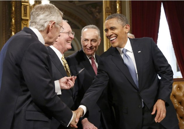 Obama laughs with Reid, Alexander, and Schumer after signing a proclamation after swearing-in ceremonies in the U.S Capitol in Washington