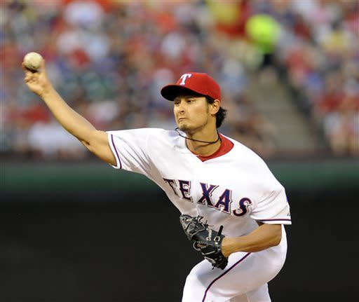 Darvish gets boost from bats, Texas tops Chisox